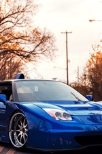 Preview iPhone wallpaper Acura blue supercar at sunset