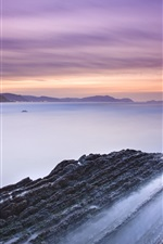 Preview iPhone wallpaper Spain beach rocks, bay, sunset
