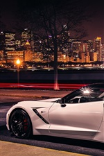 Preview iPhone wallpaper Chevrolet Corvette Stingray Coupe C7 white car at city night