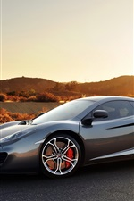 Mclaren MP4-12C gray sports car at sunset