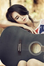 Preview iPhone wallpaper Asian guitar girl taking a break