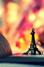 Preview iPhone wallpaper Eiffel Tower model, book, colorful lights