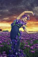 Preview iPhone wallpaper Girl in the garden, purple tulips flowers