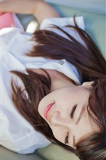 Preview iPhone wallpaper Girl lying bed, guitar, music