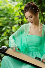 Preview iPhone wallpaper Asian girl playing the zither