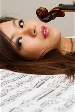 Preview iPhone wallpaper Asian girl, violin, music, bed
