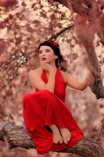 Red dress girl on the tree