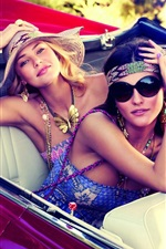 Two girls in supercar