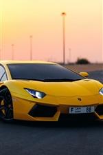 Yellow Lamborghini Aventador supercar at dusk