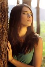 Preview iPhone wallpaper Girl in the forest, close eyes, feeling sun