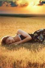 Preview iPhone wallpaper Girl sleep, grass, dusk, sunlight