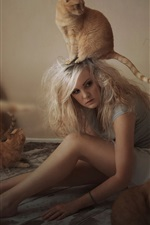 Girl with cat in room