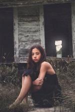 Preview iPhone wallpaper Black dress girl sit at ground, grass, hut