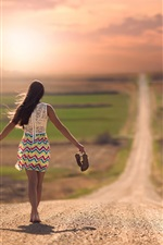 Preview iPhone wallpaper Girl walking in the road, sunset