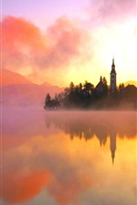 Preview iPhone wallpaper Lake Bled, northwestern Slovenia, warm morning sun, fog