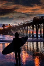 Preview iPhone wallpaper Night, sea, surfer, waves, pier, people