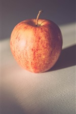 Preview iPhone wallpaper One red apple in the shadow