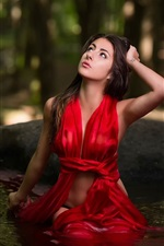 Red dress girl in water