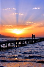 Preview iPhone wallpaper Seashore, sea, beach, bridge, two people, sky, sunset, skyline
