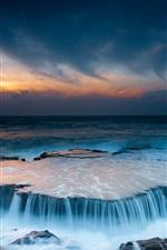 Beautiful landscape, ocean, beach, stones, sunrise