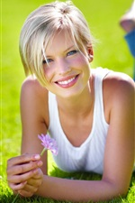 Preview iPhone wallpaper Blonde girl, grass, flower, smile