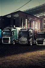 Preview iPhone wallpaper Volvo, trucks, bridge, sunset