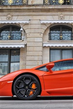 Preview iPhone wallpaper Lamborghini Aventador LP700-4 orange supercar side view, buildings