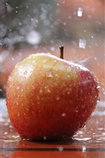 Preview iPhone wallpaper Red apple in the rain, water splash