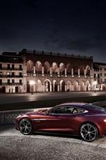 Aston Martin AM310 red supercar at city night