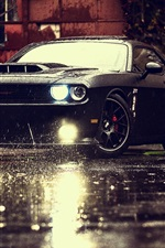 Dodge Challenger SRT black muscle car, rain