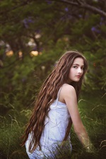 Preview iPhone wallpaper Girl in the grass, long hair, look, nature
