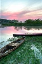 Poland, Biebrza National Park, lake, boats, dawn, summer