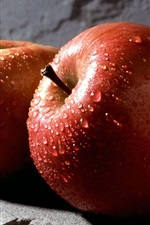 Preview iPhone wallpaper Two red apples, water drops