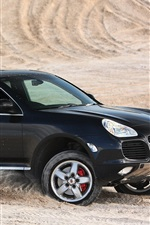 Preview iPhone wallpaper Porsche Cayenne Turbo black SUV car in desert