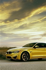 Preview iPhone wallpaper BMW M4 Coupe F82 yellow car side view