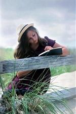 Girl read book, fence, outdoor