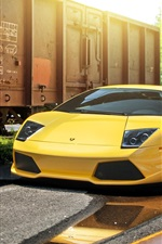 Preview iPhone wallpaper Lamborghini Murcielago LP640-4 yellow supercar, train