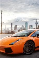 Preview iPhone wallpaper Lamborghini Gallardo orange supercar, city, sun, glare