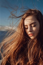 Preview iPhone wallpaper Long hair girl, portrait, sunlight, wind