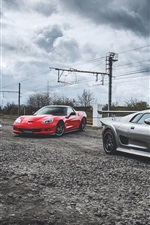 Preview iPhone wallpaper Three luxury supercars, dusk, road