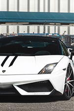 Preview iPhone wallpaper White Lamborghini supercar front view, fence