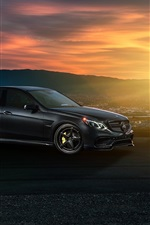 Preview iPhone wallpaper Mercedes-Benz E63 AMG S black car, sunset