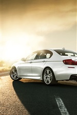 Preview iPhone wallpaper BMW M550D F10 white car rear view, road