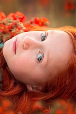 Preview iPhone wallpaper Red hair girl lying in flowers