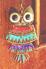 Owl pendant, gate, still life