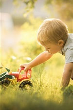 Preview iPhone wallpaper Boy play toy, bulldozer