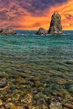 Sea, rocks, dusk sky