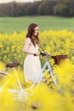 Preview iPhone wallpaper Smile girl, joy, bike, yellow flowers, field