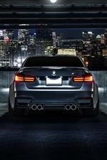 iPhone壁紙のプレビュー BMW M3のF80のマットブラックの車のリアビュー、夜、市