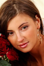 Preview iPhone wallpaper Beautiful girl and red rose flowers
